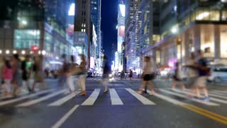anonymous people crossing street in new york city at night