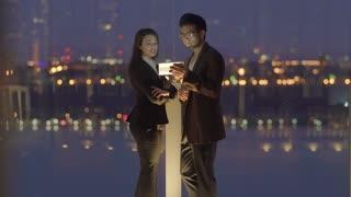 asian man talking to white women using tablet pc