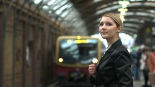 attractive blond women waiting for train