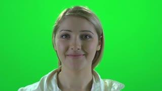 beautiful attractive women touching her hair against green screen