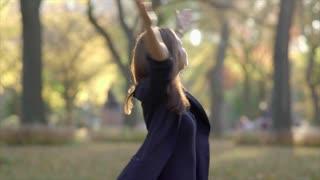 Beautiful young women enjoying colorful autumn park. happiness lifestyle scene