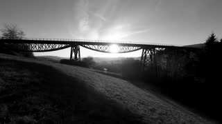 black and white silhouette of bridge scenery landscape at sunset magic hour sky
