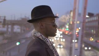 black man walking through the city at night