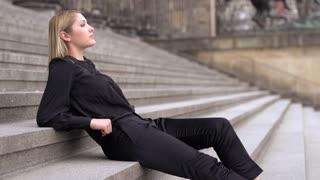 blond women female sitting outside relaxing