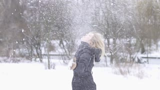 blond women playing in snow winter time slow motion