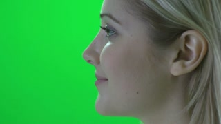 blond women profile against green screen
