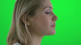 blond women profile portrait isolated green screen