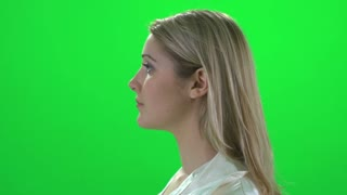 blond women side profile turning around green screen