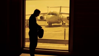 business passenger boarding at airport. jet plane standing at airport terminal