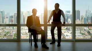 business people in high rise office building. city skyline window view