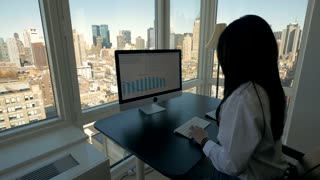 business women working on computer desk in modern high rise office building