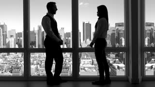businessman talking to businesswomen. women talking to man. coworkers