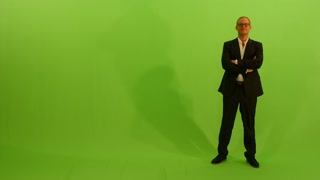 businessman walking into the frame. isolated green screen background