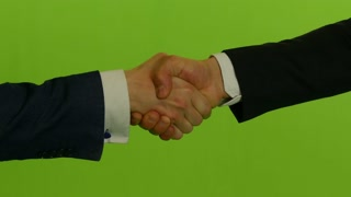 businessman's shaking hands against green screen background