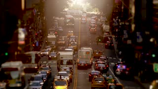 cars commuting on crowded street at rush hour time
