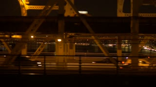 cars crossing bridge at night going to the city. urban transportation background