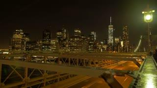 city panorama at night. traffic lights. time lapse. crossing bridge