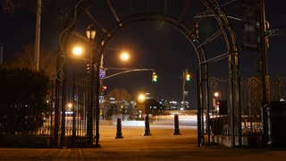 city park at night. motion time lapse. cars traffic lights background