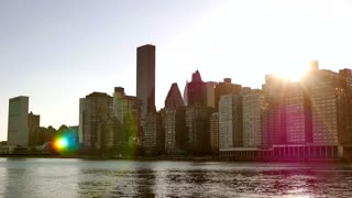 city skyline silhouette. vibrant colorful sun flare. urban lifestyle background