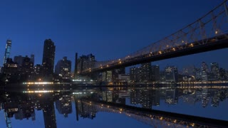 cityscape reflecting in water. night lights sky. urban background