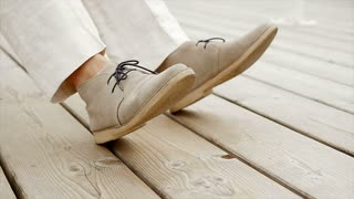 close up of shoes wiping up and down. casual male fashion. beige shoes