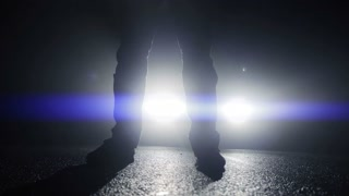 close up of walking feets in dark spooky night. police crime observation. criminal drug dealer