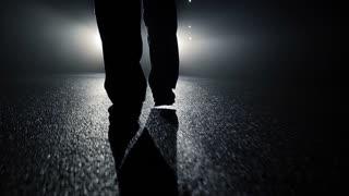 close up of walking feets in dark spooky night. police crime observation. criminal drug dealer