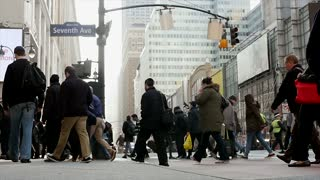 commuters crossing street in the city. new york city street scene