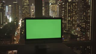 computer screen covered with green background in modern city office