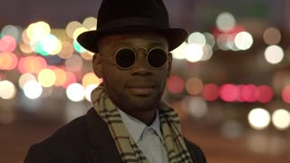 cool lifestyle portrait of one black african man in the city at night