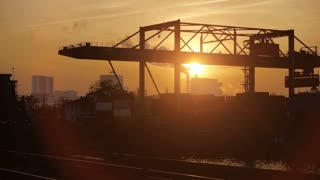cranes moving container. industrial industry business. time lapse at sunset