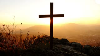 cross standing on cliff in memory of suicidal person. peaceful death background