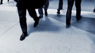crowd of business people commuting to work. walking persons background