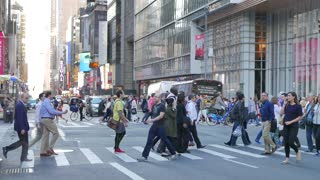 crowded city street in new york. commuters going to work