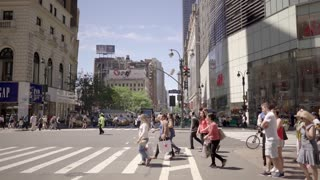 customers crossing street in shopping stores area in new york city