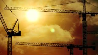 development background. business growth. crane construction. sunset sky