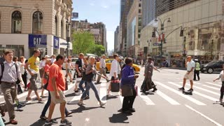 diverse people crossing street in new york city