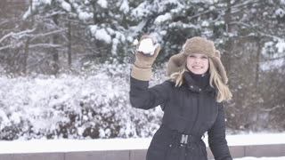 exited women throwing snow ball slow motion