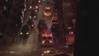 FDNY fire department truck getting emergency call in midtown manhattan at night