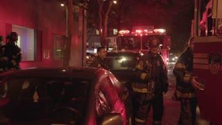 firemen entering fire trucks after successful rescue service
