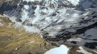 fly over snowcapped mountain panorama. winter landscape. alps glaciers