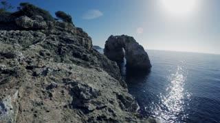 flying over steep coastal cliff rocks. epic seascape scenery