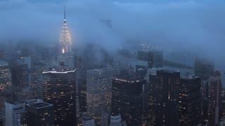 fog over new york city skyline time lapse