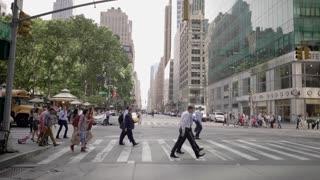 following crowd of people crossing street in new york city