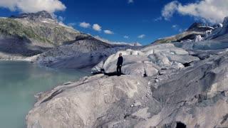 global warming melting ice glacier background. single man hiker