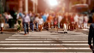 group of people crossing street in the city