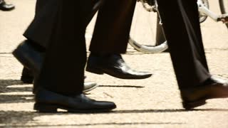 group of people walking together. slow motion. business people. shoes feet foots