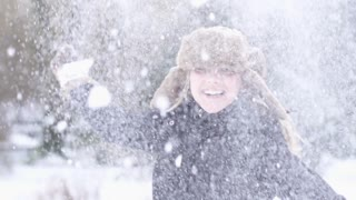 happy women exited playing spinning fun snow fall winter time slow motion