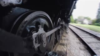 historical steam engine train driving on railroad. nostalgic industrial locomotive background