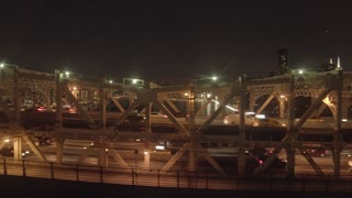 hyper lapse of cars crossing bridge at night. traffic lights